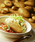 Baked potato with vegetable mousse and tomatoes; potatoes