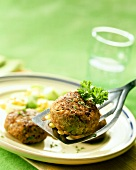 Rissole with sweetcorn and parsley on server