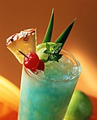 Cocktail with Blue Curacao, exotic fruit and ice cubes