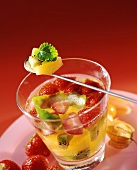 Glass of punch with strawberries and exotic fruit