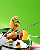 Fondue with shrimps, meat and vegetables