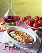 Cannelloni with mince filling in tomato sauce; red wine