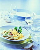Tagliatelle with julienne vegetables & duck (blue lighting)