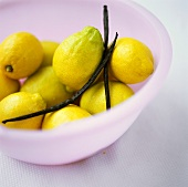 Lemons in dish with vanilla pods