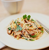 Rice noodles with mushrooms, peanuts, spring onions, coriander