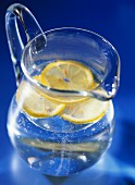 Water with lemon slices in carafe