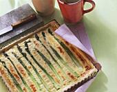 Green asparagus tart in the baking dish