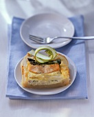 Salmon & asparagus quiche, garnished with cucumber strips