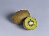 Whole and half kiwi fruit