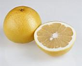 A whole grapefruit and half a grapefruit