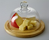 Various Types of Cheese Under Glass Dome