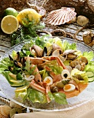 Seafood platter with egg, caviare, vegetables and salad