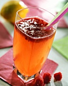 Sundowner; cocktail with rum, champagne and raspberries