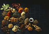 Exotic spices on black bamboo mat
