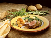 Rack of lamb in parsley coating with green beans