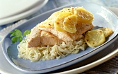 Sauerkraut casserole with salmon trout and potatoes