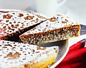 Poppy seed cake with icing sugar (pieces cut)