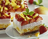 Strawberry and mango gateau with chopped pistachios