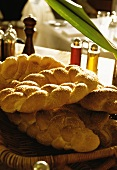 Sesame plait in bread basket on table