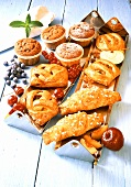 Assorted sweet pastries with fruit filling and muffins
