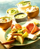 Apples with ham, cheese and various dips