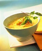 Pumpkin soup with coconut cream and Thai basil