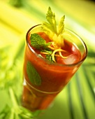 Tomato and celery drink with mint leaves