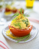 Baked tomatoes with fish puree stuffing