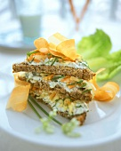 Wholemeal bread triangles with soft cheese, nuts and carrots