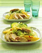 Chicken salad with mango, cucumber and iceberg lettuce