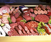 Sausage counter with many different types of sausage
