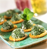 Cheese cracker with chopped mint