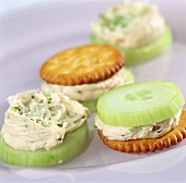 Cracker and cucumber slices with ham mousse