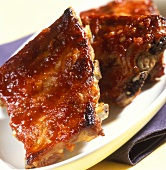 Crispy barbecued spare-ribs on white plate