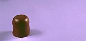 Chocolate marshmallow on mauve background