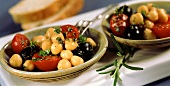 Chick-pea salad with cherry tomatoes, olives and herbs