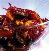 Red cabbage salad with grapes, oranges and walnut kernels