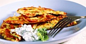 Colourful vegetable rosti with sour cream and parsley