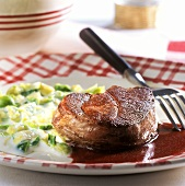 Venison steak with Brussels sprouts and red wine sauce
