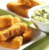Fish fingers with green herb and caper sauce