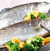 Steamed whitefish with broccoli and carrots