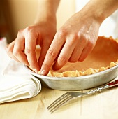 Making a tart: shaping the pastry rim