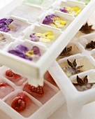 Flavoured ice cubes: edible flowers, raspberries, star anise