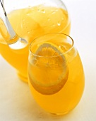 Citrus fruit drink with ice cubes