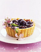 Cherry tartlets with flower decoration