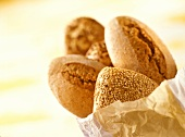 Assorted wholemeal rolls in paper bag