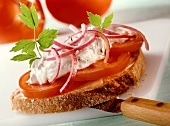 Open sandwich with tomatoes and sour cream and lovage mousse