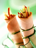 Ham and vegetable rolls, tied with chives