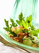 Rocket salad with Galia melon, smoked ham and nuts