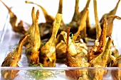 Carciofi arrostiti (roast artichokes with garlic)